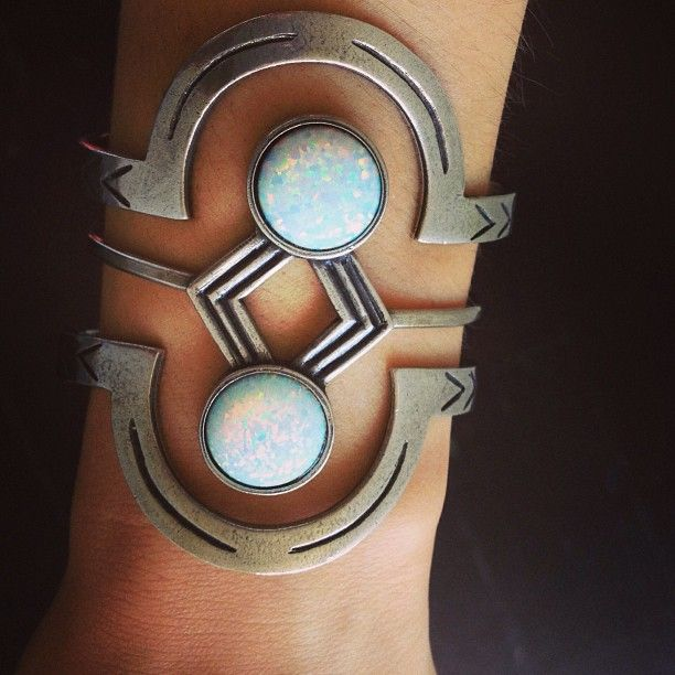 I'd change the (what looks like) opals to a deep blue stone.  But very cool design.