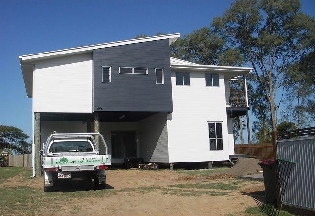 Two Storey Design with feature wall built in Beechmere, Queensland | Tru-Built Builders Queensland