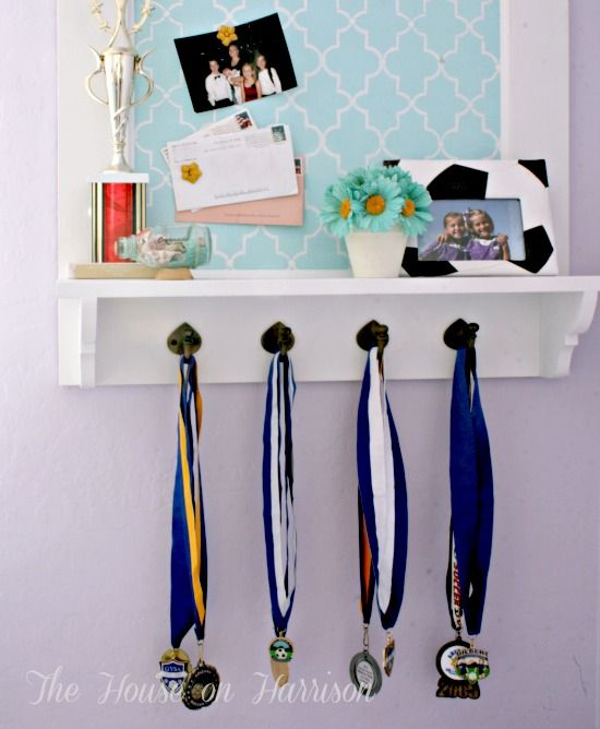 For trophies and medals. Like how you can display other stuff on the magnetic board