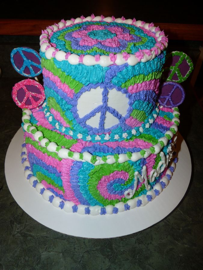 Made for a tie dye and peace themed birthday party for a 9 year old. The peace signs on the cake are made from chocolate (on popsicle sticks).