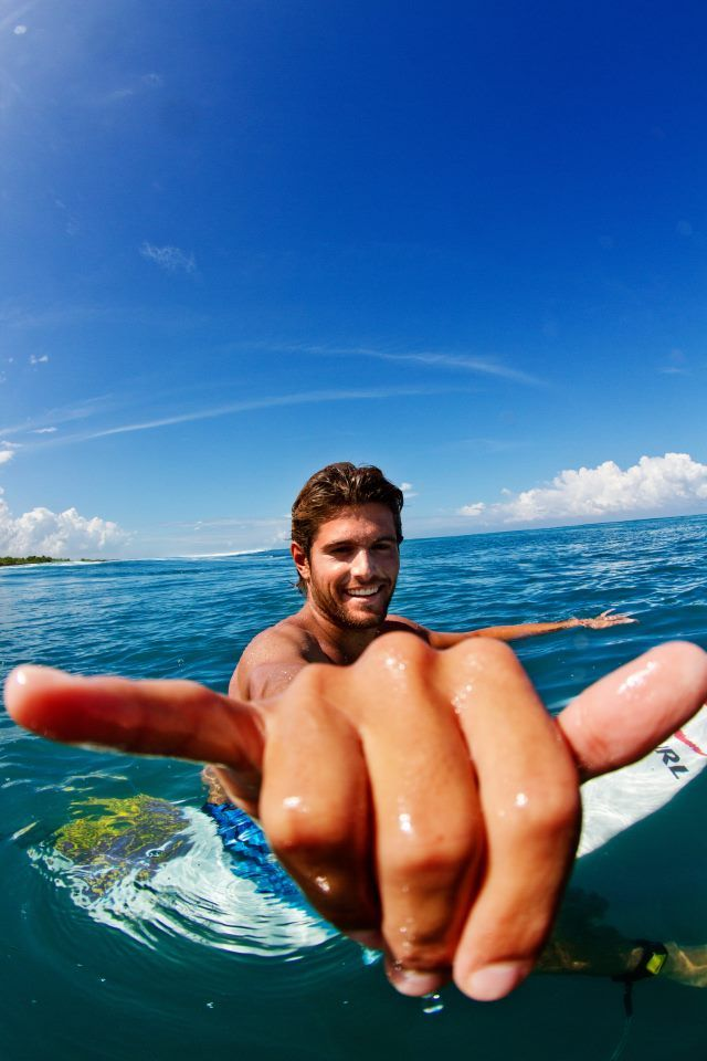 I do not know who this is, but.... Hot surfer guy!  Surfline.com