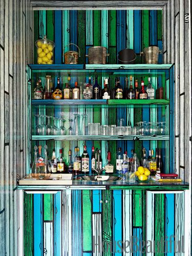 Artist Richard Woods works his fun, faux-bois magic on the bar, transforming a closet-like space into a vivid focal point.