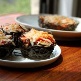 Black bean spaghetti nests with vegan ricotta and vegan cheese shreds. Vegan protein at its finest!