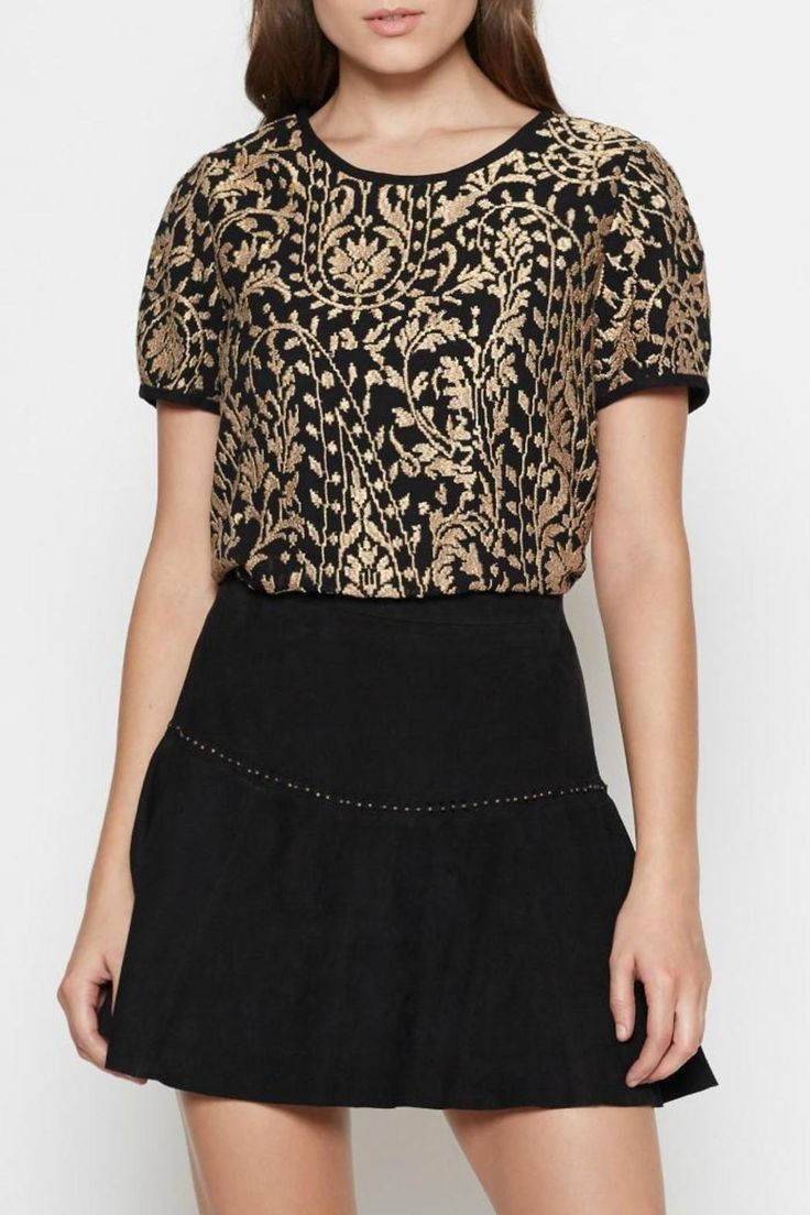 This metallic embroidered top by Joie features a crewneck, back zipper closure and intricate detailing. Perfect paired back to a flirty skirt, as shown or your favorite black denim for a toned down appeal. Dry clean.   Janpath Top by Joie. Clothing - Tops - Short Sleeve Clothing - Tops - Casual Clothing - Tops - Work Canada