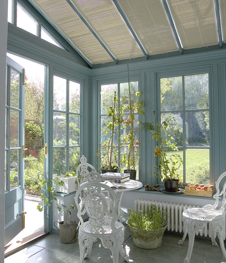 National Trust Conservatory collection - gorgeous blue heritage colour and rattan blinds make this a beautiful place to relax,