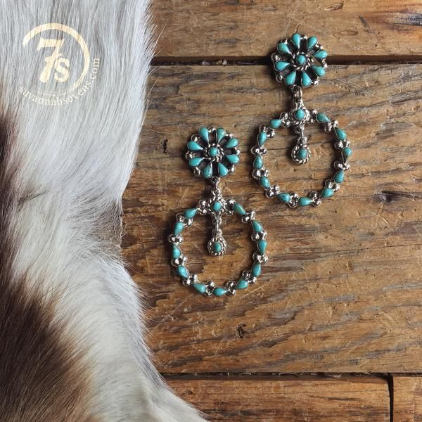 Hico Earrings - Turquoise drop chandilier earrings. Sterling silver setting and back. Turquoise floral pattern top concho with oval bottom drop. Sterling silver postsHandcrafted in Texas.