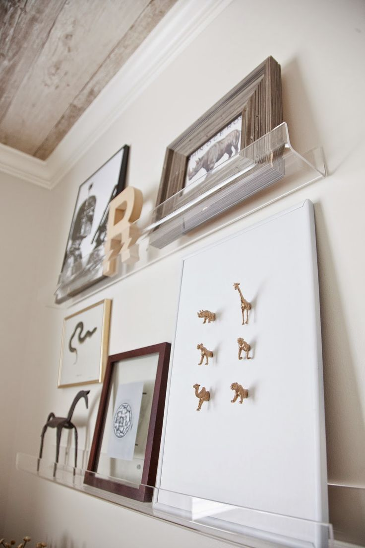 Floating acrylic shelves make switching up art and accessories a breeze.