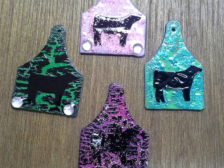 A brand new, Stockyard Style original! Eartag pendants with bright colors, sparkles, and black show cattle silhouettes. www.stockyardstyle.com