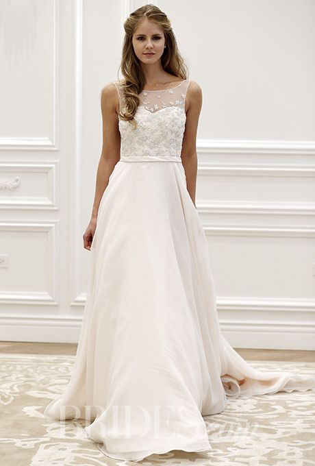 An A-line @annebargebride wedding dress with an embellished illusion neckline | Brides.com