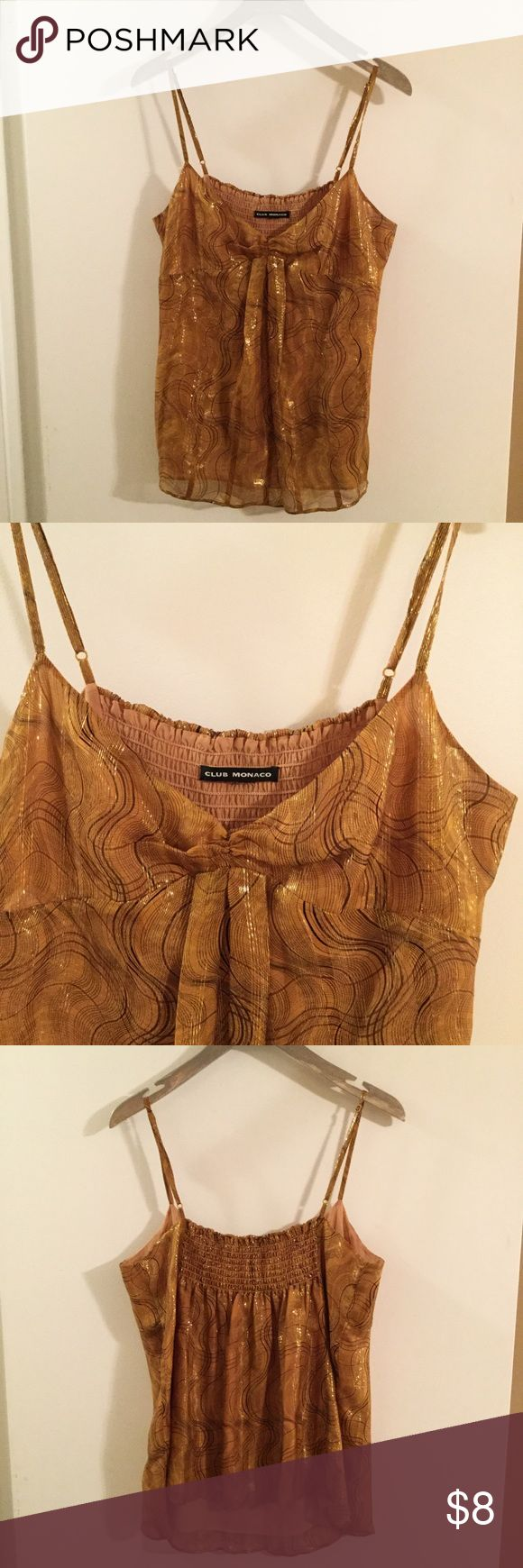 Club Monaco Gold Metallic Silk Cami Top size Med Women's Gold Metallic Cami Top by Club Monaco. Size medium but size and fabric label has been cut out. Silk fabric, dry clean only. Sleeveless with adjustable spaghetti straps. Elasticized back. Lined. Dark gold cooler with brown pattern. Gold metallic thread woven through. Good condition, no holes, stains or pilling. Club Monaco Tops Camisoles