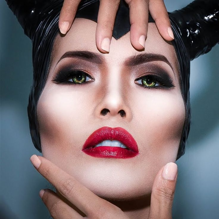 Inspired by Maleficent: A smokey black eye with a dramatic contour and perfect red lip. Possibly an ombre lip?