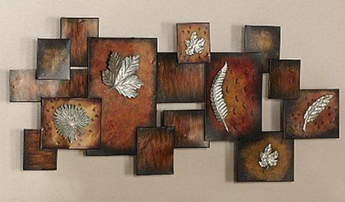 """Leaves/abstract Panel Wall Art, 19.25""""Hx40""""W, MULTI by Home Decorators Collection. $89.00. 19.25""""H x 40""""W x 3.5""""D.. The Leaves/Abstract Panel Wall Art is a great combination of nature and contemporary design. With its warm, earthy tones and embossed leaf patterns, this home accent is a modern work of art for any nature lover. Add this beautiful art to your order today.Constructed of metal, it features various squares and rectangles that are painted in warm ear..."""