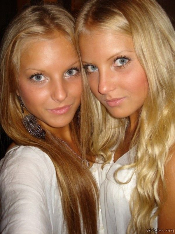 Gorgeous blonde twin girls with sexy blue eyes
