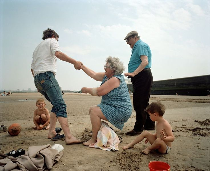 Martin Parr - England. New Brighton. Holidaymakers on the beach. 1984.