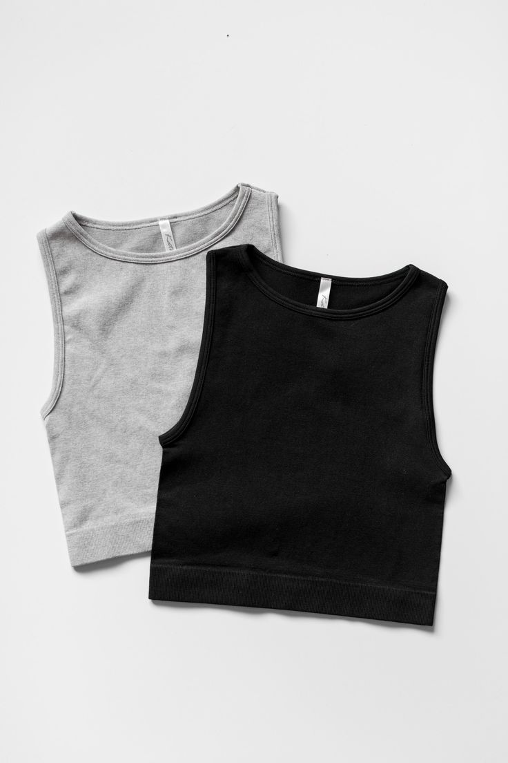 Seamless and sleeveless knit crop top with a high neckline. Made with stretchy nylon material. Can be worn many different ways as a casual top or even a workout tank! Available in grey or black. - 95%