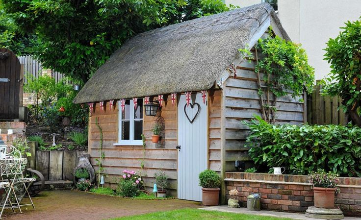 The Little Thatch shed owned by Gemma and Jamie Dix, from Bedford, the winner of the Garden Office category of the 2014 Shed of the Year competition sponsored by Cuprinol.