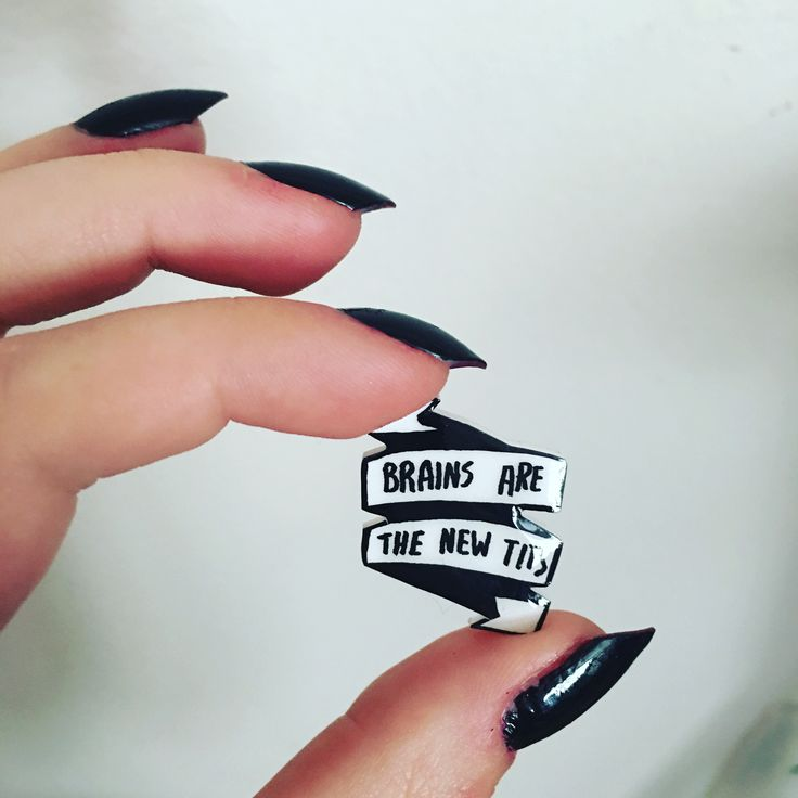 """Brains are the new tits"" feminist quote lapel pin. Punk rock grunge accessory and style."