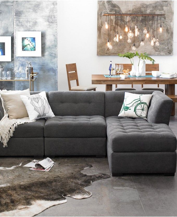 Elegant Gray Modular Sectional Sofa With Decorative Cushions And Cowhide Rugs Plus Concrete Flooring Also Linear Chandelier For Living Room Design