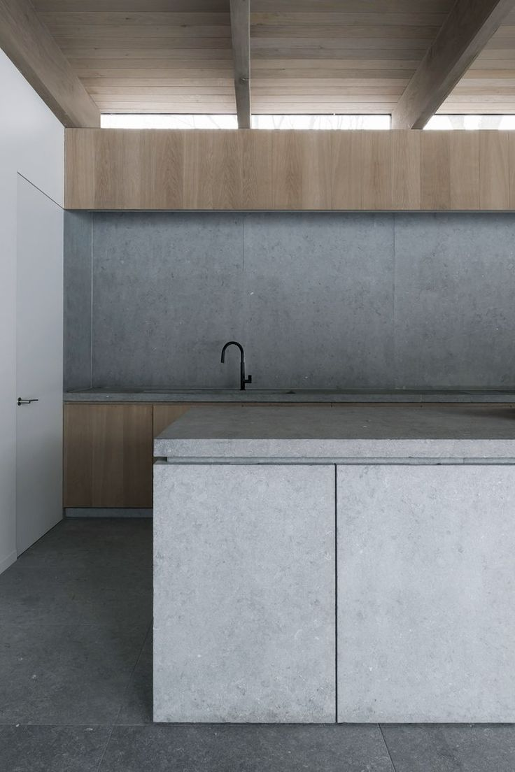 Minimal concrete and timber kitchen.