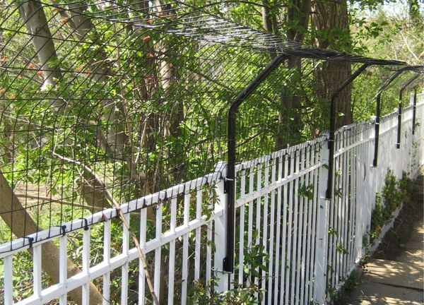 fence extenders | Fence Extension Arm - This would work well in a chicken run with netting to cover the open area as well!