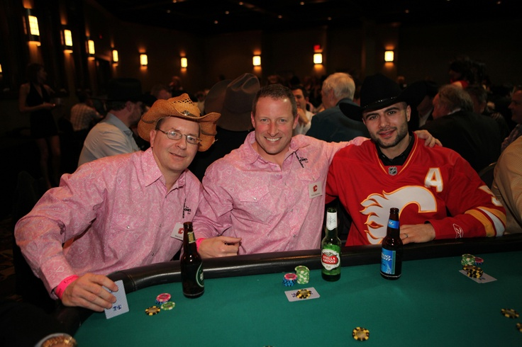 Mark Giordano and a couple of the players at his table at the 2013 Texas Hold 'Em Tournament!