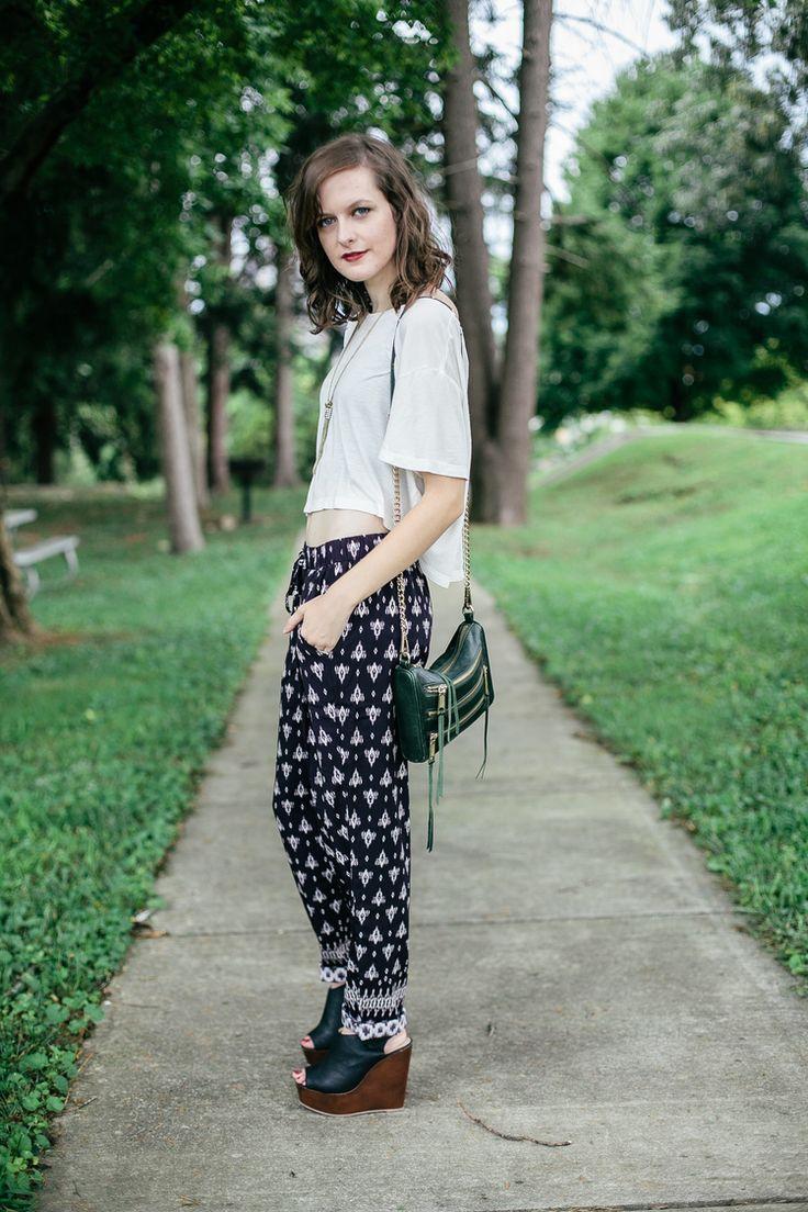 Printed pants, white crop top, platform wedges from Mint Julep Boutique, Rebecca Minkoff mini 5 zip crossbody