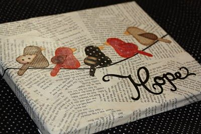 canvas with newspaper decoupaged and bird cut outs. Could use any object or any type of paper