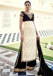 Nargis Fakhri In Sizzling Cream Color Heavy Embroidered Straight Suit
