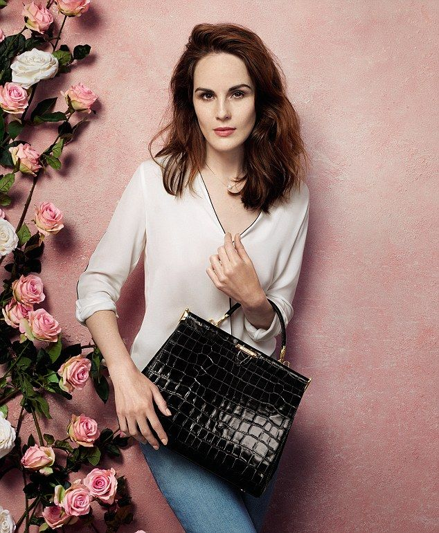 Downton Abbey starMichelle Dockery has unveiled her new handbag collection for the Middleton sisters' favourite brand, Aspinal of London