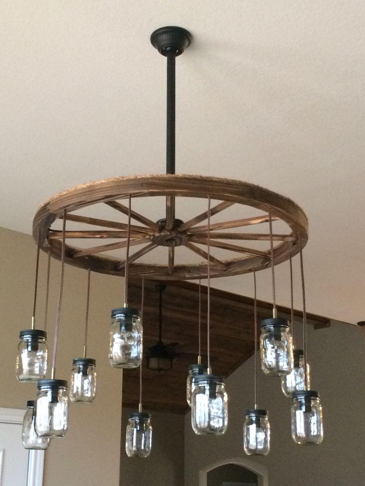 Wagon wheel chandelier, mason jars