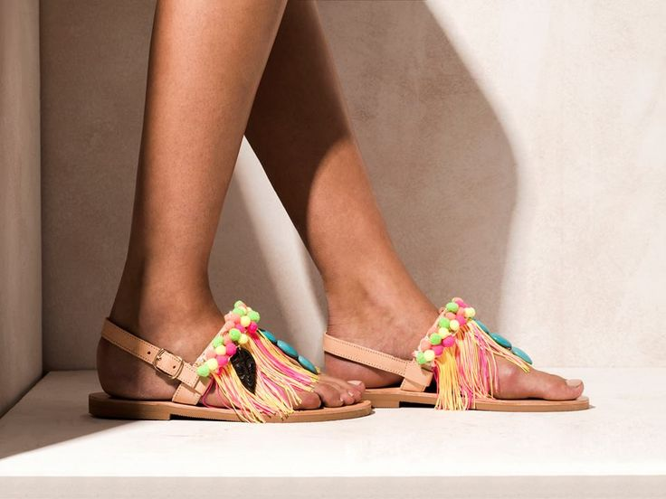 Batida di Coco  Hand-sewn neon-colored pom poms, cotton fringes in yellow and hot pink colors, turquoise stones and statement hand-carved tribal motifs.  Get the experience: http://www.elinalinardaki.com/shoes/sandals/new-collection/sandal-batida-di-coco/