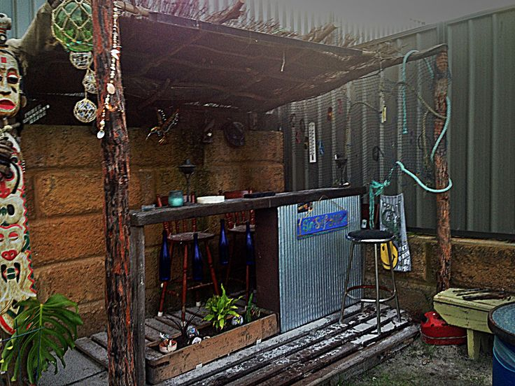 This outdoor bar shows a great use of recycled materials.  Melissa & Michael Barton