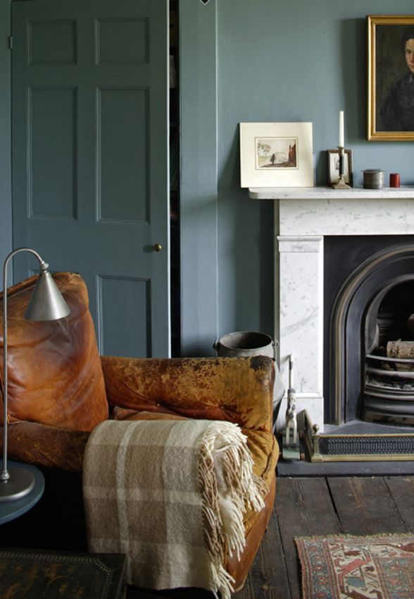Gorgeous dusty blue walls and elegant simple marble fireplace