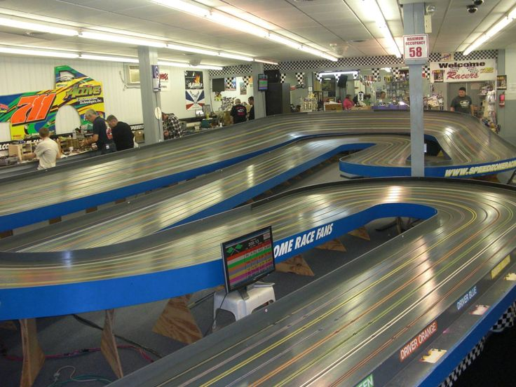 Slot car racing is the hobby of racing miniature electric-powered replicas of full size cars on a track layout with