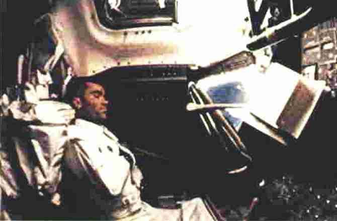 Fred Haise attempts sleep during the Apollo 13 mission. | NASA