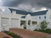 Located in the prestigious De Zalze Golf Estate, this house is surprisingly affordable.