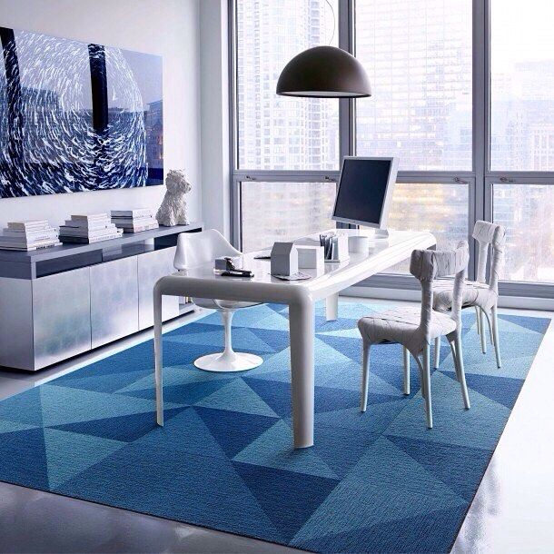 Beat the heat with the cooling 'Waves of Blues' color-inspired carpet styles by @FLORSquares. Shown here is 'Breakdancer' a bold graphic pattern with diagonals & squares in 'Cobalt' 'Ocean' & 'Tidal' a perfect splash of  Summer color.  Made from 100% recycled materials FLOR squares are easily washable ideal for a beachside châlet where sandy feet might frequent or a water-themed office space. Stop in to #FLORSoHo today & browse 'Waves of Blues' & more delightful color-inspired themes at…