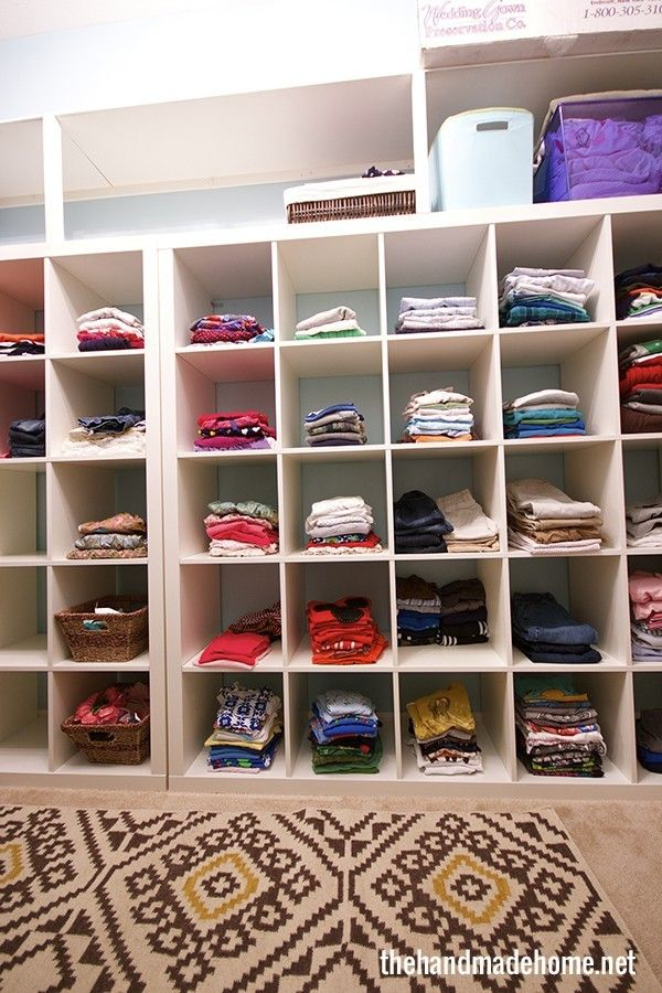 Family organized all their kids clothes into one closet with cubbies to make this unique storage system.