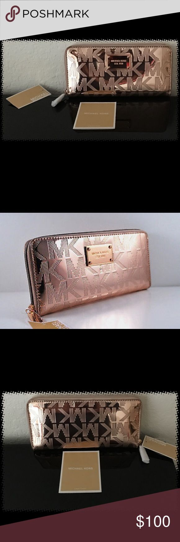 NWT-MICHAEL KORS ROSE GOLD MIRROR METALLIC WALLET NWT-MICHAEL KORS ROSE GOLD MIRROR METALLIC CONTINENTAL ZIP AROUND WALLET*THIS BEAUTIFUL WALLET IS MADE OUT OF ROSE GOLD MK SIGNATURE MIRROR METALLIC GENUINE LEATHER*REPEATED SIGNATURE MK LOGO.  FULL ZIP-AROUND CLOSURE**SIGNATURE ROSE GOLD TONE LOGO PLATE ON FRONT*INTERIOR- DIVIDER ZIPPER COIN COMPARTMENT IN THE MIDDLE*2 FULL LENGTH SLIP POCKETS; 1 ON EACH SIDE**4 CREDIT CARD SLIP POCKETS ON EACH WALL (8 TOTAL)GOLD GENUINE LEATHER…
