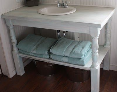Shabby Creek Cottage- Hand built vanity. Porch railings from Home Depot ($13 each), were made into the legs, 1x6s are the bottom shelf, and the top is made of birch plywood. We painted it with my favorite shabby & beachy treatment, then coated with poly for protection.