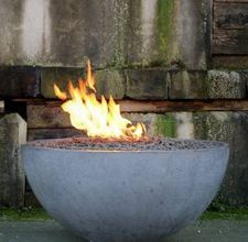 DIY concrete fire pit - this is pretty cool. Also, it's above ground which would be a lot easier