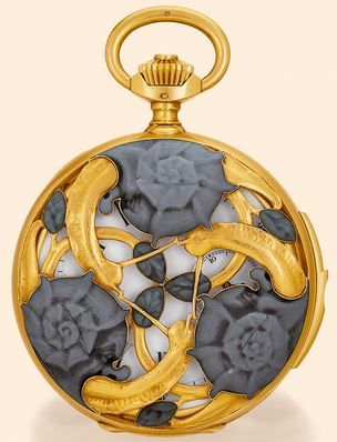Escargot pocket watch by Rene Lalique, shown at the 1900 exhibition in Paris. Three snails decorate the case both back and front, having green pate de verre, red lacquer, white enamel and gold. Signed