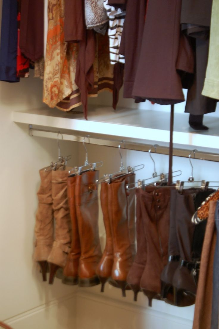 Hang boots in closet with pant hangers.