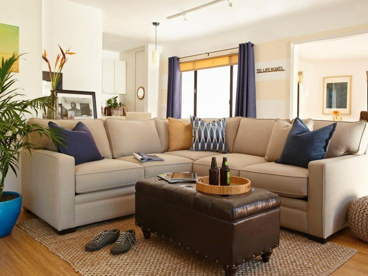 This calm space was designed for a dad who wanted his kids to feel comfortable visiting and to be able to relax after long work days. A sisal rug, slubby woven couch fabric and nautical accents. Design: Laurie March