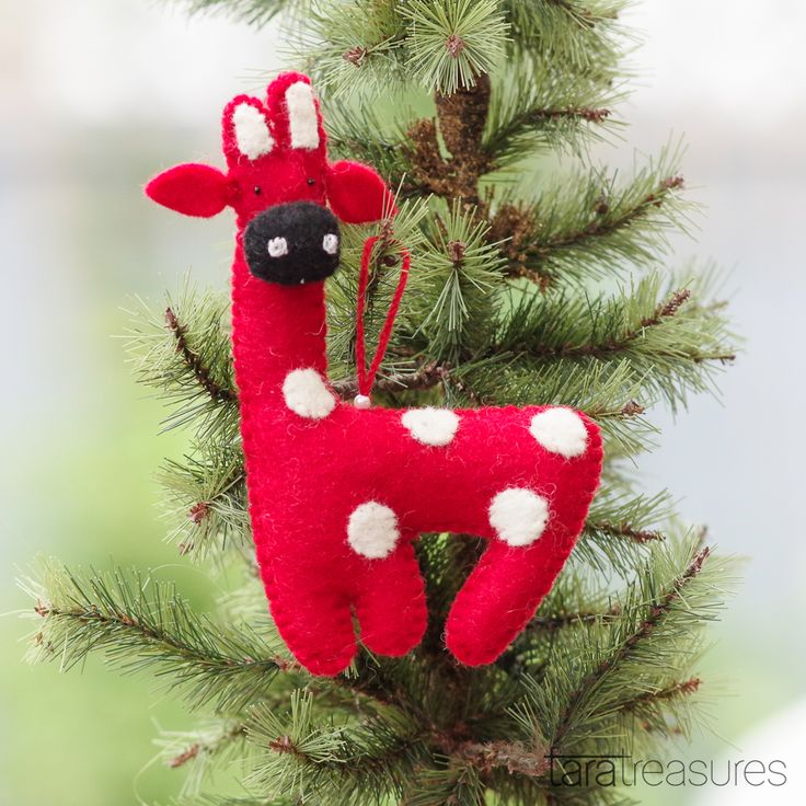The red giraffe is one of our most popular Christmas hangings. Grab other felt hangings from Tara Treasures's market stalls. #christmas