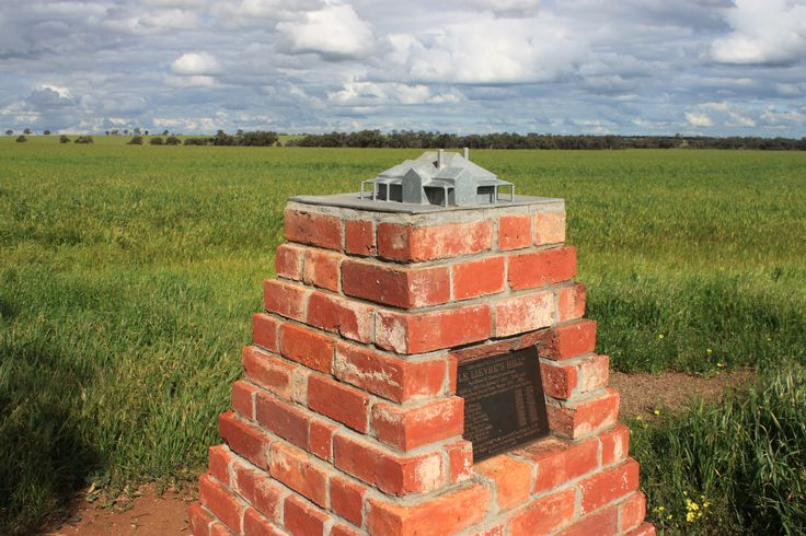 """Cairn for 'Le Lievre's Hill"""" the Thalia homestead built in 1901 for Edward & Mary Ann Burns. The 38square building was relocated to Malmsbury in 1997."""