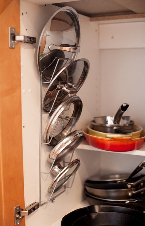 Reclaim never-used space (like the walls of a cupboard) with vertical storage. You can purchase a dedicated pot lid rack that operates like this, but a magazine rack is another clever stand-in. See more at Simple Bites »  - GoodHousekeeping.com