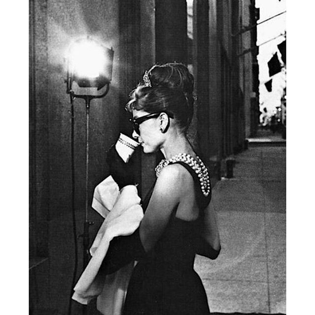 Audrey Hepburn photographed in a publicity still for Breakfast at Tiffany's ☕ #AudreyHepburn #NationalCoffeeDay #HollyGolightly #BreakfastAtTiffanys