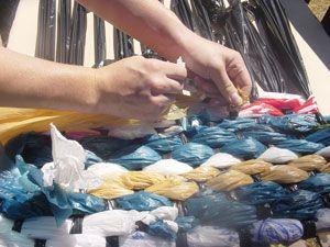 Rug. Plastic grocery bags.