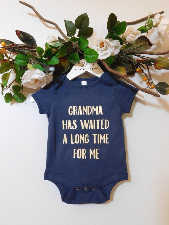These adorable onesies are the perfect way to show off your new grand baby! Or even better, to give your mom the big news that you are pregnant!    PLEASE ALLOW 2 WEEKS FOR ONESIE TO SHIP (time depends on how busy we are with orders). Items are shipped FIRST CLASS so shipping takes 2-5 business days.     Onesies run true to size (please see size chart below).    COLOR UPGRADE INCLUDED, long sleeve is not available in onesies that are not white.    IF YOU NEED THIS ITEM SOONER, PLEASE LOOK AT…
